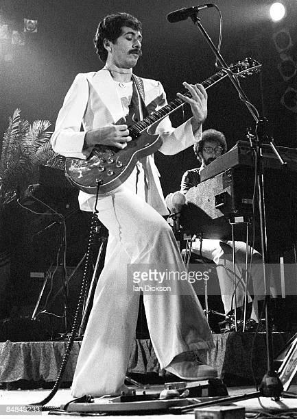 Photo of Carlos SANTANA playing Yamaha SG175B guitar using wahwah pedal