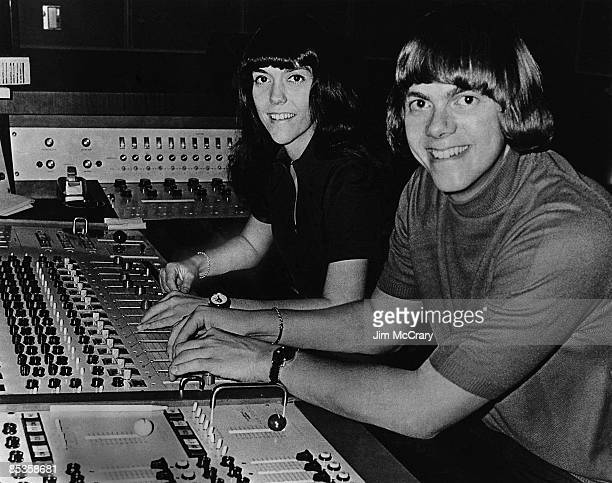 Photo of CARPENTERS and Richard CARPENTER and Karen CARPENTER Karen Caprenter and Richard Carpenter at mixing desk in recording studio