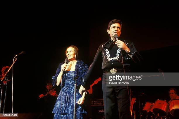 ODEON Photo of CARTER FAMILY and June CARTER and Johnny CASH Johnny Cash performing on stage with wife June Carter Cash