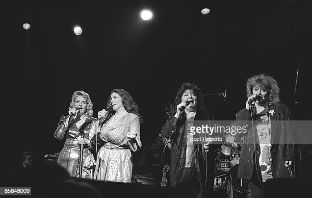 Photo of CARTER FAMILY and June CARTER; L-R Carlene Carter, June Carter Cash, Anita Carter and Helen Carter performing on stage