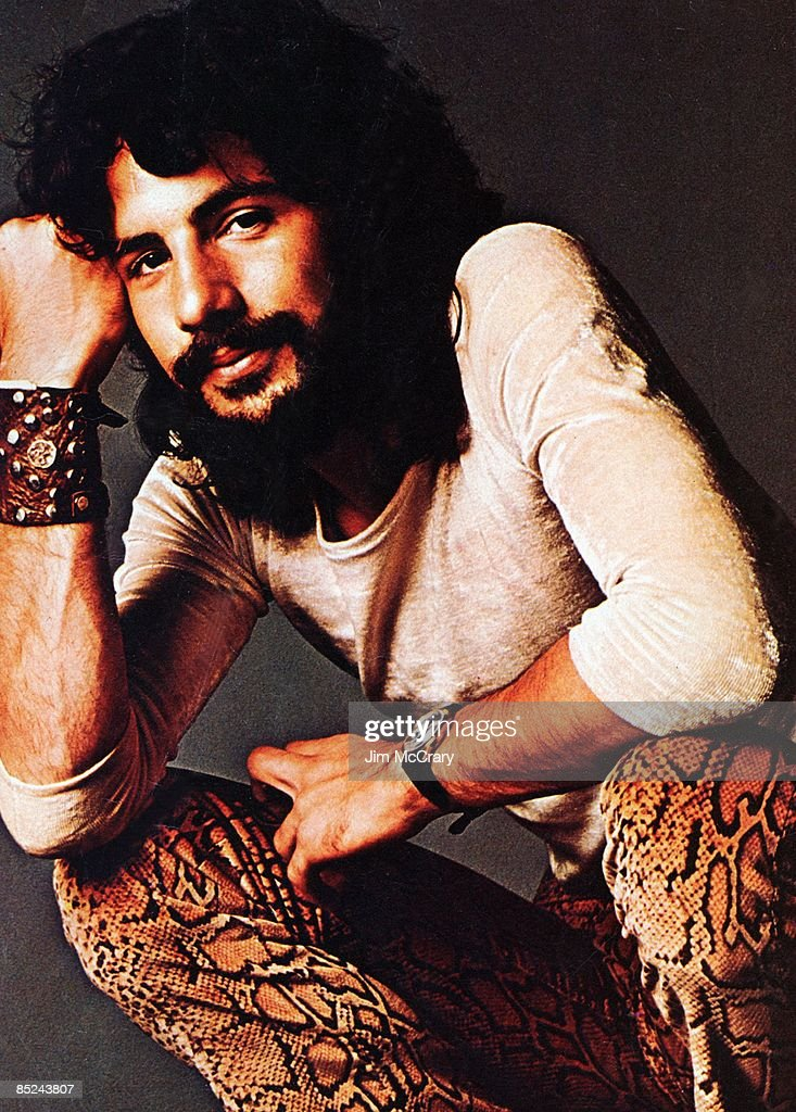 Photo of Cat STEVENS; posed, at A&M studio
