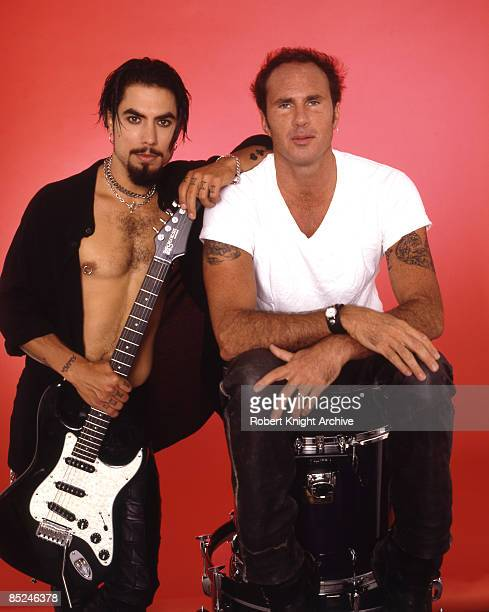Photo of Chad SMITH and Dave NAVARRO and RED HOT CHILI PEPPERS LR Dave Navarro Chad Smith posed studio