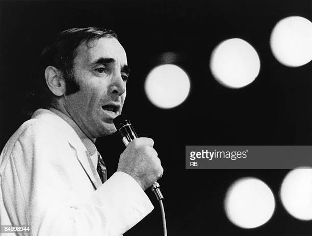 Photo of Charles AZNAVOUR Charles Aznavour performing on stage early 70's