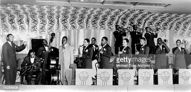Photo of Charlie Parker Carlie Parker with the Jay Nc Shann Orchestra NYC NY 1942 Identified musicians left to right Jay McShann far left Gene Ramey...
