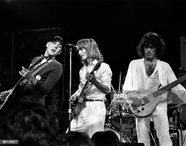 CLUB Photo of CHEAP TRICK and Robin ZANDER and Tom PETERSSON and Rick NIELSEN LR Rick Nielsen Robin Zander and Tom Petersson performing on stage