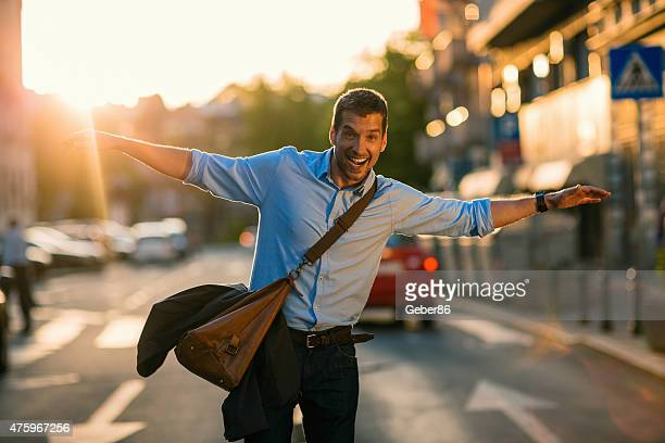 Photo of cheerful man walking with arms outstretched
