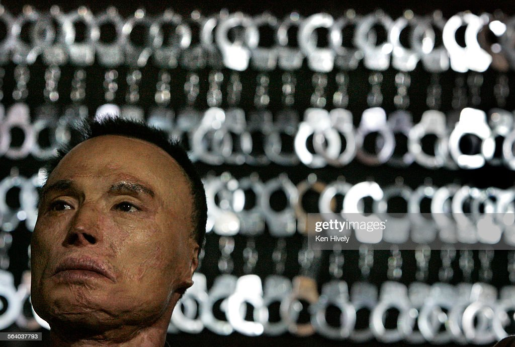 Photo of Chol So Lee, wrongfully convicted stands in front of handcuffs used during ceremony where : News Photo