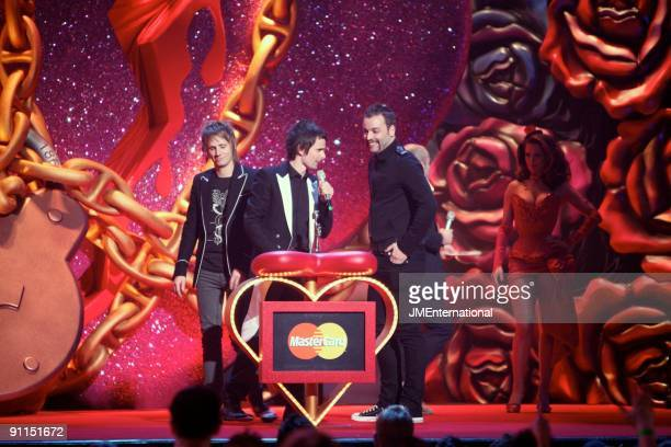 Photo of Chris WOLSTENHOLME and Dominic HOWARD and Matt BELLAMY and MUSE, L-R: Dominic Howard, Matt Bellamy, Chris Wolstenholme accepting the award...