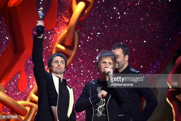 Photo of Chris WOLSTENHOLME and Dominic HOWARD and Matt BELLAMY and MUSE, L-R: Matt Bellamy, Dominic Howard, Chris Wolstenholme collecting the award...