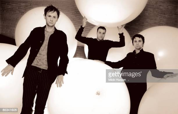 Photo of Chris WOLSTENHOLME and MUSE and Dominic HOWARD and Matt BELLAMY; L-R: Dominic Howard, Chris Wolstenholme, Matt Bellamy - posed, group shot