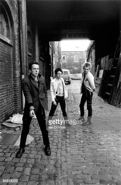 Photo of CLASH and Joe STRUMMER and Paul SIMONON and Topper HEADON LR Joe Strummer Topper Headon Paul Simonon posed group shot