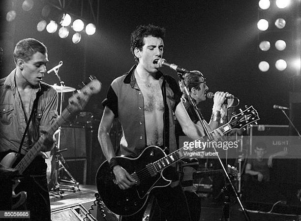 PALAIS Photo of CLASH and Mick JONES and Joe STRUMMER and Paul SIMONON LR Paul Simonon Mick Jones Joe Strummer performing live onstage