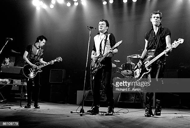 PALLADIUM Photo of CLASH and Mick JONES and Joe STRUMMER and Topper HEADON and Paul SIMONON Group performing on stage LR Mick Jones Joe Strummer...