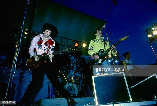 Photo of CLASH and Mick JONES and Terry CHIMES and Joe STRUMMER and Paul SIMONON Group performing on stage LR Mick Jones Terry Chimes Joe Strummer...