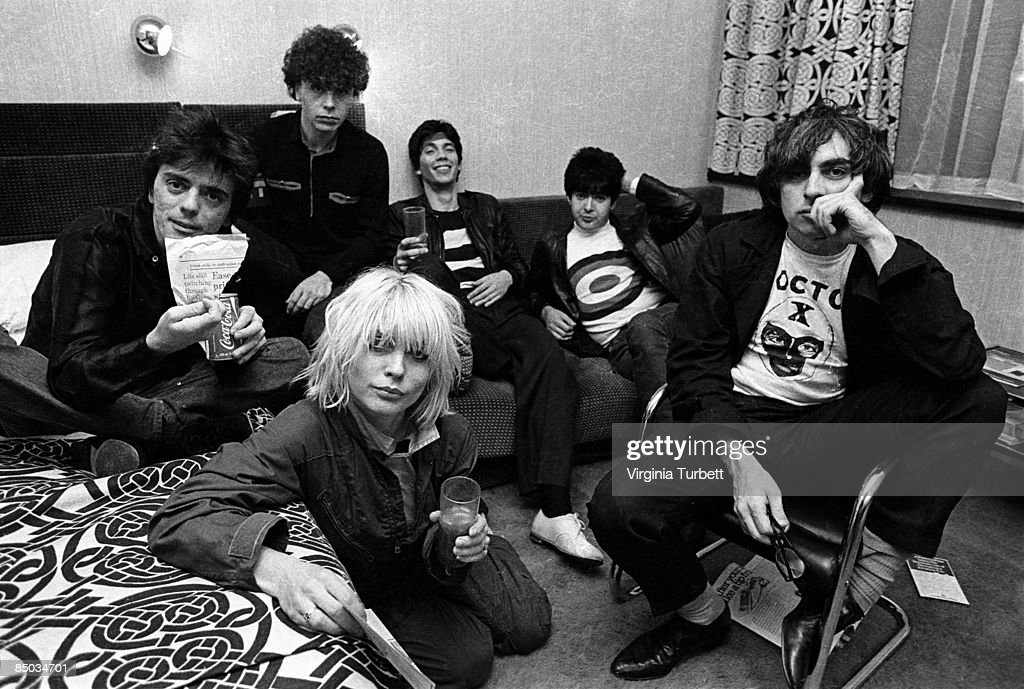 Photo of Clem BURKE and Chris STEIN and Debbie HARRY and BLONDIE; Back L-R: Frank Infante (on bed with can of coke), Nigel Harrison, Jimmy Destri, Clem Burke. Front L-R: Debbie Harry, Chris Stein