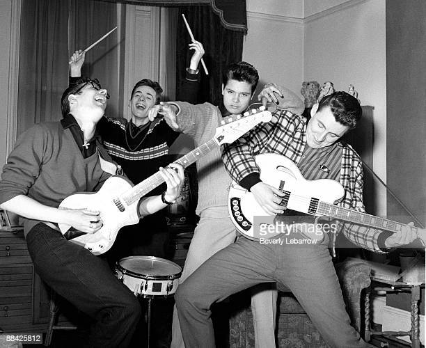Photo of Cliff RICHARD and SHADOWS; posed with The Shadows - L-R: Hank Marvin, Tony Meehan, Cliff Richard, Bruce Welch - c.1959