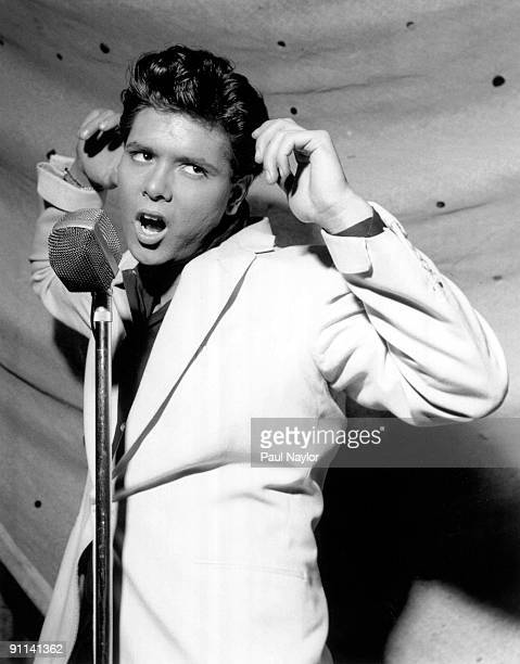 Photo of Cliff RICHARD performing live onstage singing into microphone
