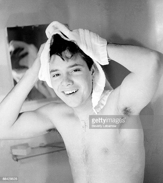 Photo of Cliff RICHARD posed in bathroom drying hair with towel c1958/1959