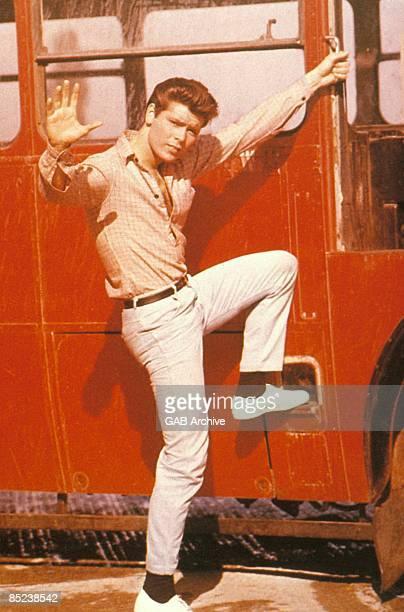 Photo of Cliff RICHARD still from film 'Summer Holiday' climbing onto bus