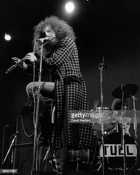 FESTIVAL Photo of Clive BUNKER and Ian ANDERSON and JETHRO TULL Ian Anderson performing live onstage playing flute standing on one leg with Clive...