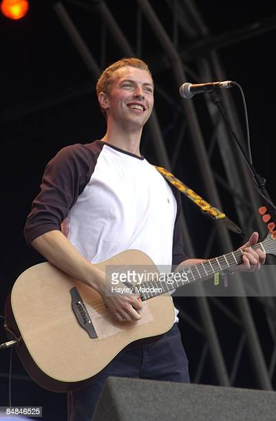 Photo of COLDPLAY Chris Martin performing live onstage