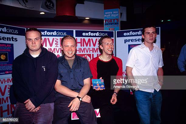 Will Champion Jonny Buckland Chris Martin Guy Berryman posed group shot at instore appearance