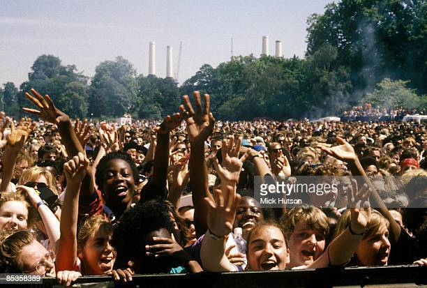 Photo of CONCERT and FANS and TEEN FANS and CROWDS a young crowd gathered for a gig in Battersea Park