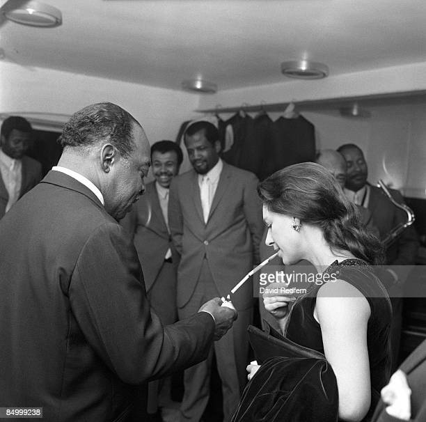 MALTINGS Photo of Count BASIE and Princess MARGARET with Princess Margaret lighting her cigarette in holder backstage