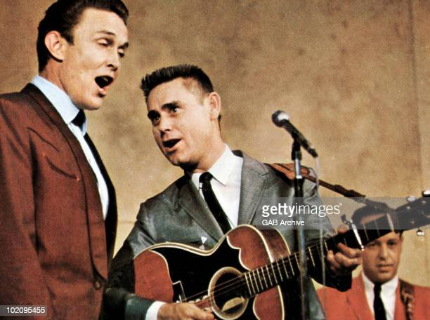Photo of Country Music singer s Jimmy Dean and George Jones performing live on stage in the early 1960's