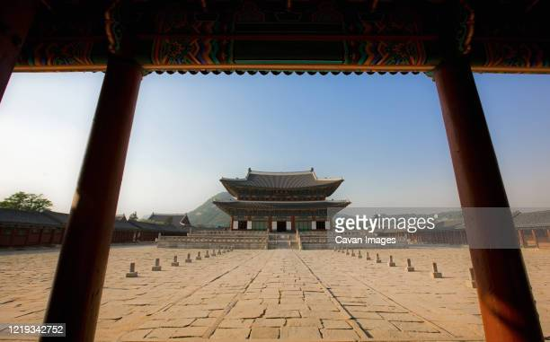 photo of courtyard at the royal palace gyeongbokgung in seoul - south korea stock pictures, royalty-free photos & images