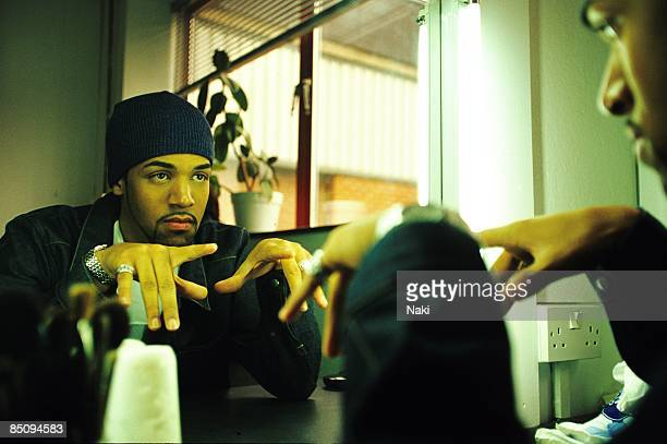 Photo of Craig DAVID Posed portrait of Craig David on the set of his 'Fill me In' video looking in the mirror