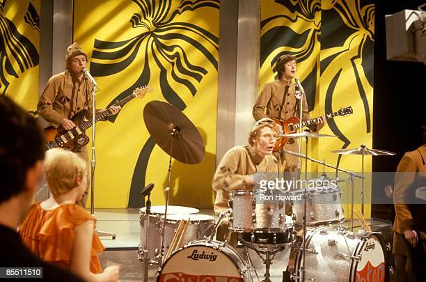 POPS Photo of CREAM and Ginger BAKER and Eric CLAPTON and Jack BRUCE LR Jack Bruce Ginger Baker Eric Clapton performing wearing prison uniforms