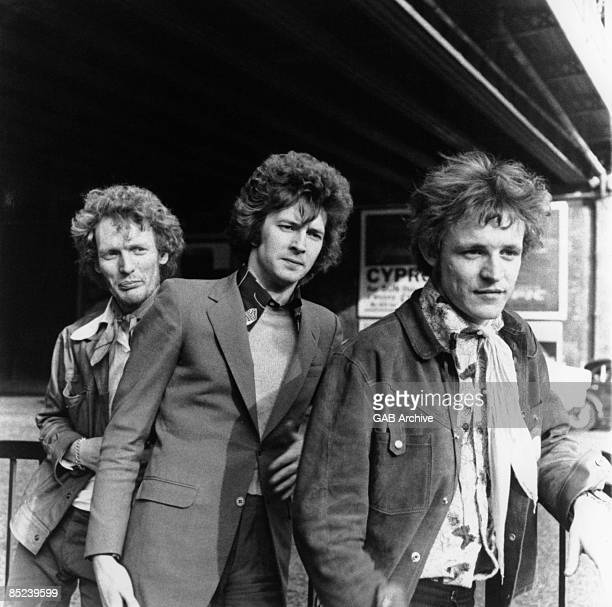Photo of CREAM L to R Ginger Baker Eric Clapton Jack Bruce posed group shot