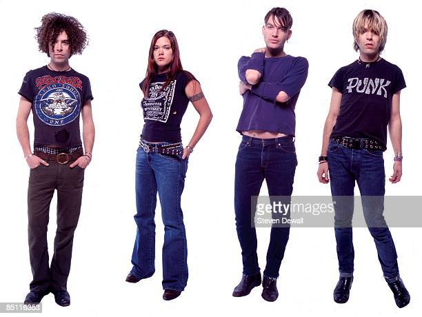 Photo of DANDY WARHOLS and Brent De BOER and Zia McCABE and Courtney TAYLORTAYLOR and Peter HOLMSTROM Posed studio group portrait LR Brent DeBoer Zia...