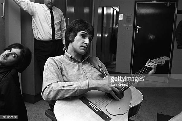 Photo of Dave DAVIES and KINKS and Ray DAVIES, Dave Davies & Ray Davies backstage in dressing room at 'A Whole Scene Going' TV show, holding Fender...
