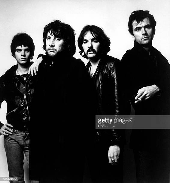 Photo of Dave GREENFIELD and Jet BLACK and STRANGLERS and JJ BURNEL and Hugh CORNWELL; Posed studio group portrait L-R Jean Jacques Burnel, Jet...