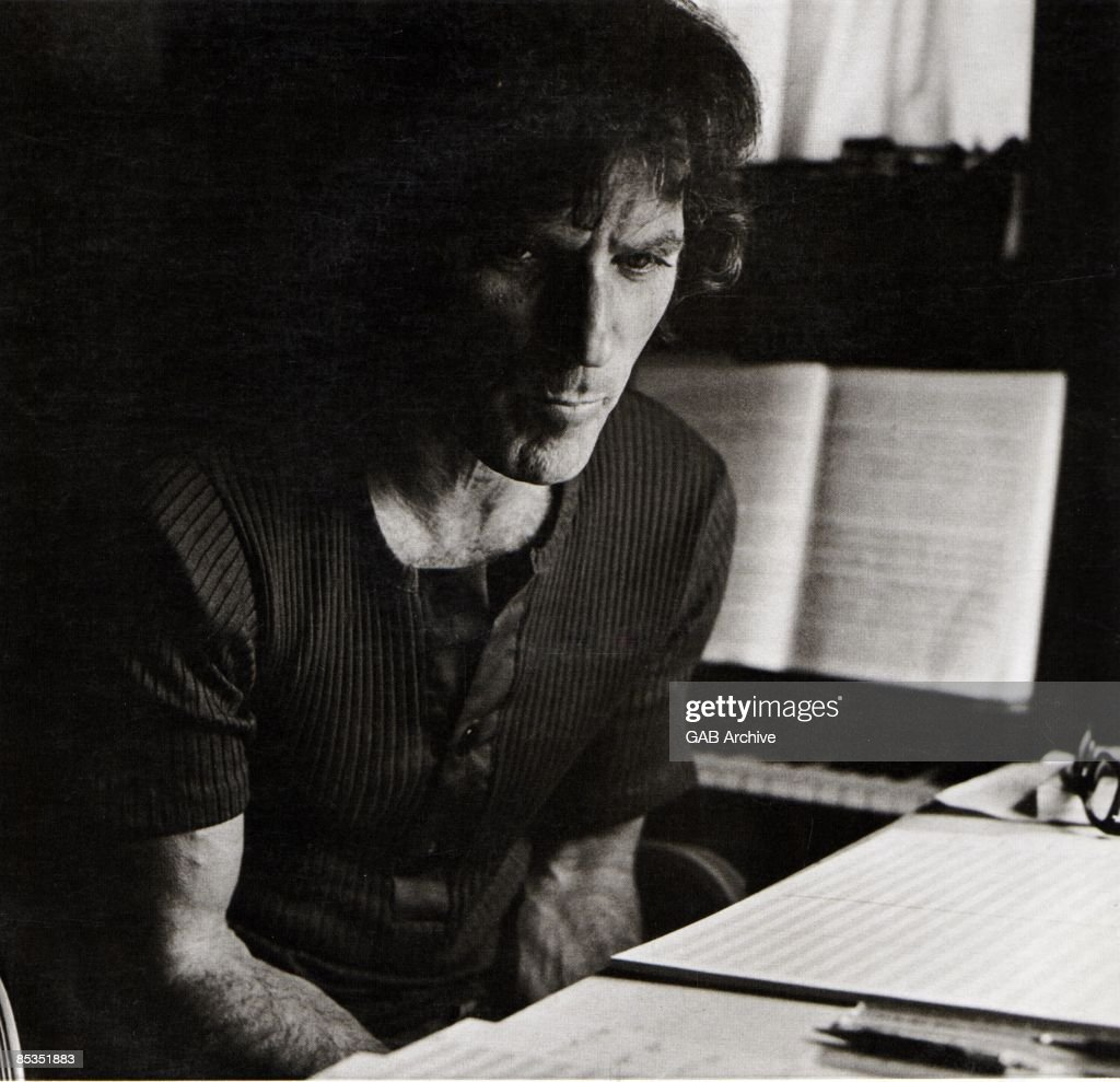 Photo of David AXELROD; Portrait sitting at a piano