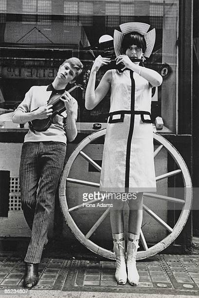 Photo of David BOWIE and MANDOLIN posed taken on Kingly Street off Carnaby Street in summer 1963 Shoot for Boyfriend magazine with model who arrived...