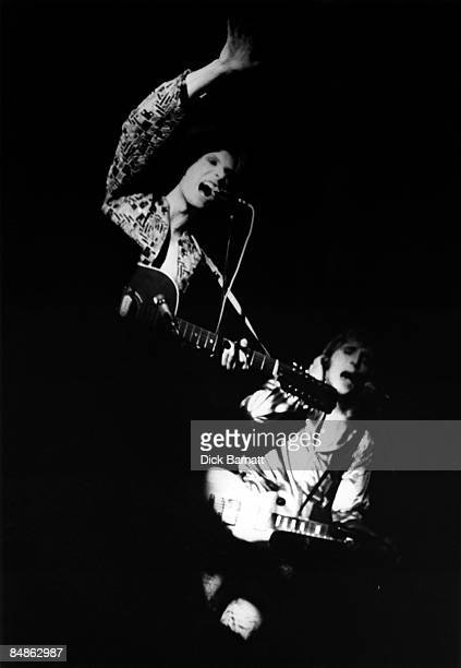 Photo of David BOWIE and Mick RONSON David Bowie and Mick Ronson performing on stage Wallington Public Hall Surrey on first Ziggy Stardust tour