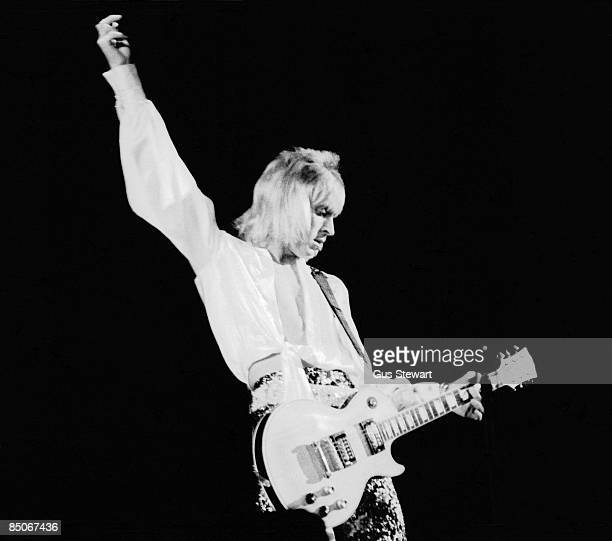 ODEON Photo of David BOWIE and Mick RONSON Mick Ronson performing on stage with David Bowie and the Spiders from Mars