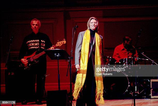 Photo of David BOWIE and Tony VISCONTI with Tony Visconti performing live onstage at Tibetan Freedom concert