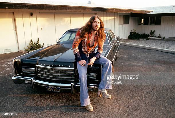 Photo of David COVERDALE and DEEP PURPLE David Coverdale posed sitting on bonnet of car