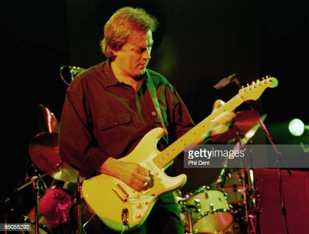 Photo of David GILMOUR, David Gilmour of Pink Floyd, performing live onstage, playing Fender Stratocaster guitar
