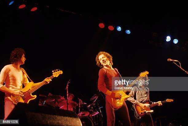 Photo of David KNOPFLER and John ILLSLEY and DIRE STRAITS and Mark KNOPFLER LR John Illsley Mark Knopfler David Knopfler performing live onstage