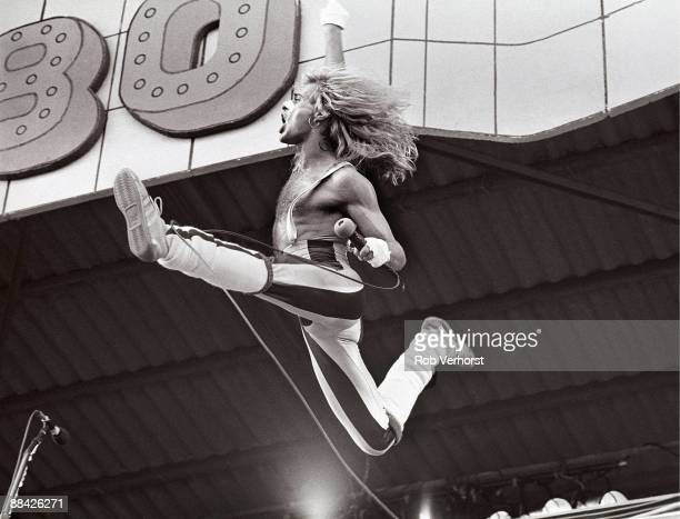 Photo of David Lee ROTH and VAN HALEN, David Lee Roth performing live onstage, jumping