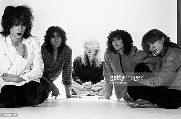 Photo of David SYLVIAN and JAPAN and Mick KARN and Richard BARBIERI and Rob DEAN and Steve JANSEN Posed studio group portrait LR Steve Jansen Richard...