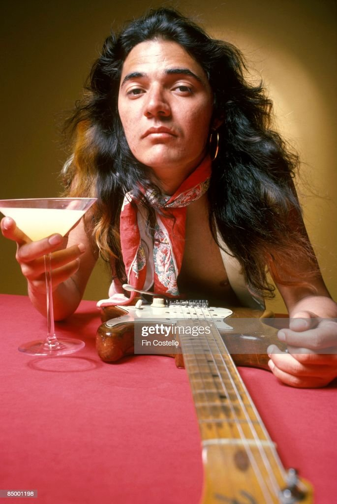 Photo of DEEP PURPLE and Tommy BOLIN; Tommy Bolin, posed, studio, with guitar and drink in cocktail glass