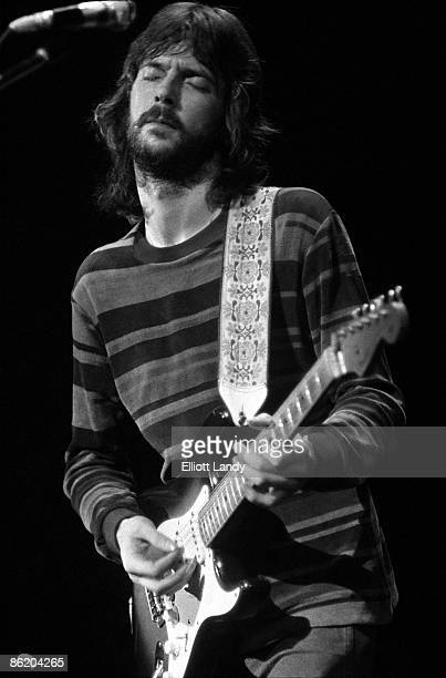 Photo of DEREK The DOMINOS and Eric CLAPTON w/ Derek The Dominos performing live onstage playing Fender Stratocaster guitar