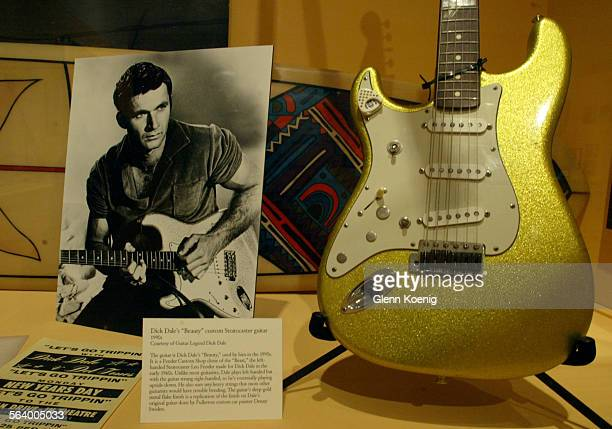 A photo of Dick Dale and Dick Dale's Beauty the custom Fender Stratocaster guitar used by Dale in the 1990's is on display at the rock n roll...