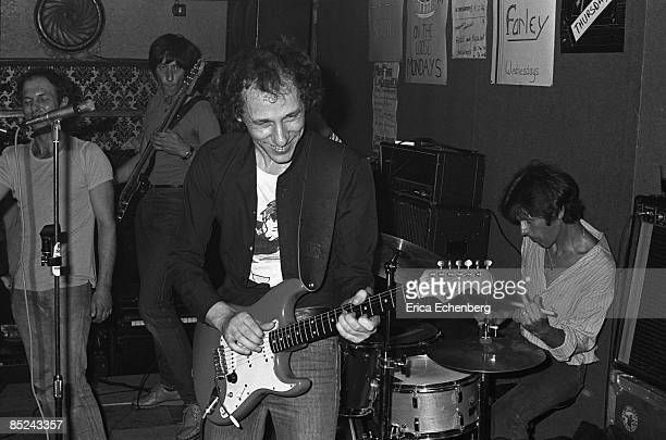 Photo of DIRE STRAITS and Mark KNOPFLER and Pick WITHERS Mark Knopfler Pick Withers drums performing live onstage in pub playing Fender Stratocaster...